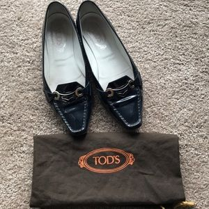 Navy Tod's patent leather loafers